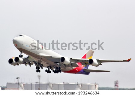 MOSCOW, RUSSIA - MAY 10, 2013: Asiana Cargo Boeing 747 takes off the Domodedovo International Airport, Russia. - stock photo