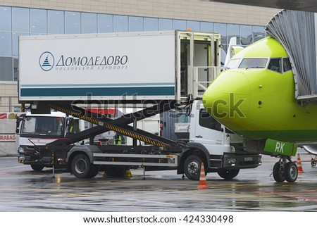 MOSCOW, RUSSIA - MAY 19, 2016: Boeing 737-800 S7 airlines loading the aircraft in-flight catering on the platform of the international airport Domodedovo. - stock photo
