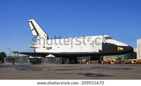 "MOSCOW, RUSSIA - MAY 21. ""Buran"" - orbiter, the Soviet reusable space transportation system in Gorky Park May 21, 2014 . ""Buran"" was the answer to a similar American project ""Space Shuttle"" - stock photo"