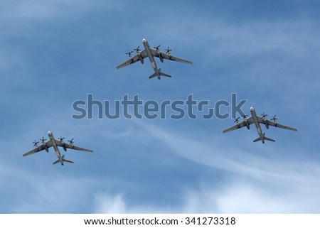 MOSCOW, RUSSIA - MAY 9, 2015: Celebration of the 70 anniversary of the Victory Day (WWII). Flight of aircraft over the city, the group of turboprop strategic bomber and missile platform Tu-95 Bear - stock photo