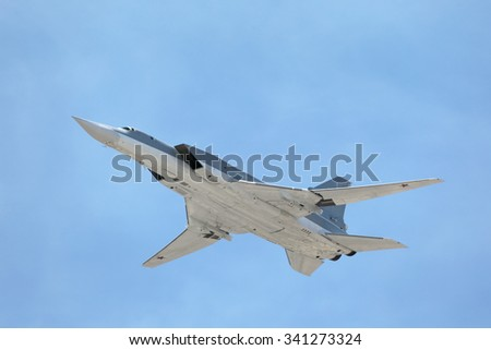 MOSCOW, RUSSIA - MAY 9, 2015: Celebration of the 70 anniversary of the Victory Day (WWII). The Tupolev Tu-22M3 (Backfire) is a supersonic strategic and maritime strike bomber in the sky over Moscow - stock photo