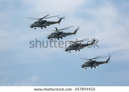 MOSCOW, RUSSIA - MAY 09, 2015: Celebration of the 70th anniversary of the Victory Day (WWII). Flight of aircraft over the city, a group of military helicopters Mil Mi-24 (Hind) in the sky - stock photo