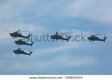 MOSCOW, RUSSIA - MAY 09, 2015: Celebration of the 70th anniversary of the Victory Day (WWII). Flight of aircraft over the city, a group of military attack helicopters Mil Mi-28 (Havoc) in the sky