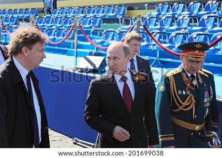 MOSCOW, RUSSIA - MAY 09, 2014: Celebration of the 69th anniversary of the Victory Day (WWII) on Red Square. Vladimir Putin and Minister of Defense Sergey Shoygu at the victory parade on the Red Square - stock photo