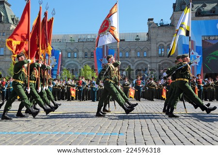 MOSCOW, RUSSIA - MAY 09, 2014: Celebration of the Victory Day (WWII). Mobile brigade of radiation, chemical and biological protection and regiment intelligence explosions - stock photo