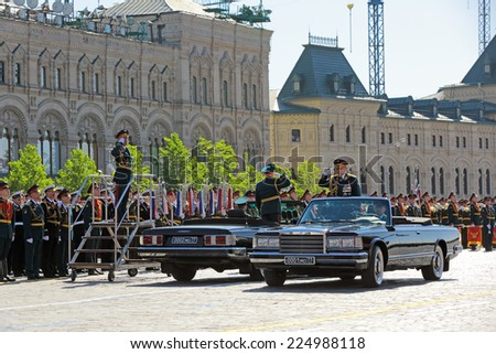 MOSCOW, RUSSIA - MAY 09, 2014: Celebration of the Victory Day (WWII) on Red Square. Chief of Land forces of Russia Oleg Salyukov and Minister of defence of the Russian Federation Sergey Shoygu - stock photo