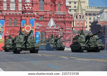 "MOSCOW, RUSSIA - MAY 09, 2014: Celebration of the Victory Day (WWII). Solemn passage of military hardware on Red Square. Russian heavy self-propelled 152 mm howitzer 2S19 ""Msta-S"" (M1990 ""Farm"") - stock photo"