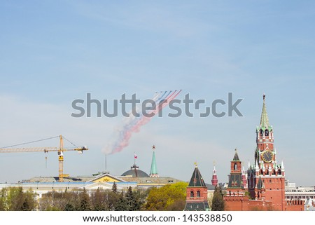 Moscow, Russia - May 9, 2013: Celebration of Victory Day in Moscow with sky air show above Red Square. Military planes making fog in colors of Russian flag. - stock photo