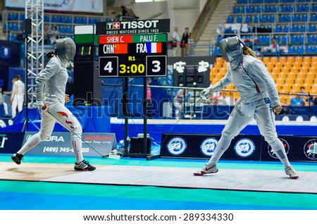 MOSCOW, RUSSIA - MAY 31 2015: Chen Shen vs Flora Palu during the World  fencing Grand Prix Moscow Saber in Luzhniki sport palace