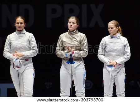 MOSCOW, RUSSIA - MAY 31 2015: E. Dyachenko, A. Komashuk and S. Velikaya just before finals on the World  fencing Grand Prix Moscow Saber in Luzhniki sport palace - stock photo