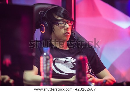 MOSCOW, RUSSIA â?? MAY 14 2016: EPICENTER MOSCOW Dota 2 cybersport event. Evil geniuses player Aui_2000 in the cabin on the stage tired