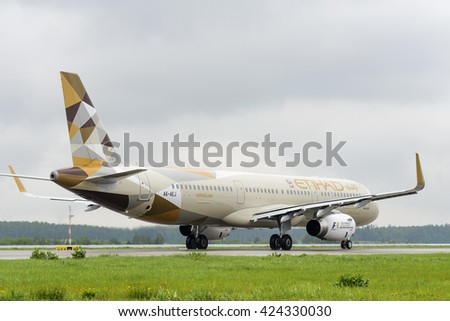 MOSCOW, RUSSIA - MAY 19, 2016: Etihad airlines Airbus A321 taxiing. Plane makes taxiing on taxiway Domodedovo International Airport. Rainy and cloudy day. - stock photo