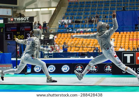 MOSCOW, RUSSIA - MAY 31 2015: Eugene Karbolina and Marta Puda fights on the World  fencing Grand Prix Moscow Saber in Luzhniki sport palace - stock photo