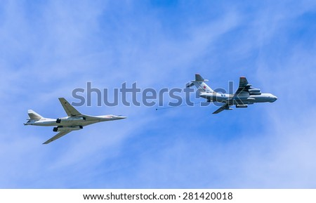 MOSCOW/RUSSIA - MAY 9: Il-78 (Midas) aerial tanker and Tu-160 (Blackjack) supersonic heavy strategic bomber demonstrate refueling on parade devoted to Victory Day aniversary on May 9, 2015 in Moscow.