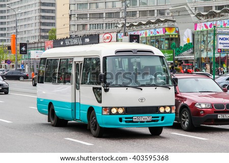MOSCOW, RUSSIA - MAY 6, 2013: Interurban bus Toyota Coaster in the city street.