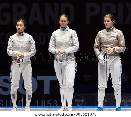 MOSCOW, RUSSIA - MAY 31 2015: Jung Kim, Alina Komashuk and Sofia Velikaya before finals on the World  fencing Grand Prix Moscow Saber in Luzhniki sport palace - stock photo
