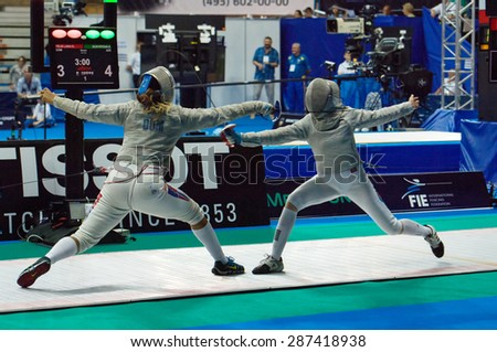 MOSCOW, RUSSIA - MAY 31 2015: Lara Felix and Sevinj Bunyatova fights on the World  fencing Grand Prix Moscow Saber in Luzhniki sport palace - stock photo