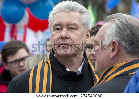 MOSCOW,RUSSIA - MAY 01: Mayor of Moscow Sergei Sobyanin in the Labor Union march dedicated to the Day of Workers' International Solidarity on Red Square in center of Moscow on 01 of May 2015, Russia - stock photo