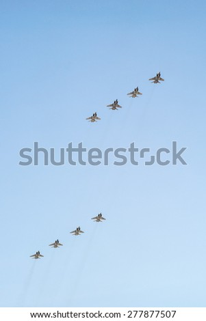 MOSCOW/RUSSIA - MAY 7: 8 Mikoyan-Gurevich MiG-31 (Foxhound) supersonic interceptor aircrafts on rehearsal of parade devoted to 70-th Victory Day aniversary on May 7, 2015 in Moscow.