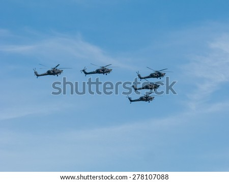 MOSCOW/RUSSIA - MAY 7: 2 Mil Mi-28N (Havoc) attack helicopters of aerobatic team Berkuty fly on rehearsal of parade devoted to 70-th Victory Day aniversary on May 7, 2015 in Moscow.