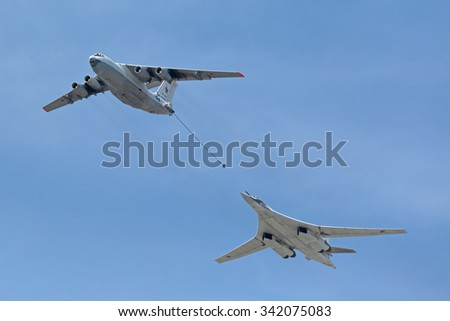 "MOSCOW, RUSSIA -?? MAY 9, 2015: Military parade of 70th anniversaries of a victory day. Flight of aircraft over the city. The tanker Il-78 and strategic bomber and missile platform Tu-160 ""White swan"""