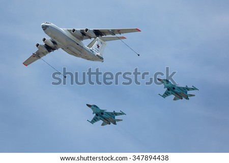 MOSCOW, RUSSIA - MAY 9, 2015: Military parade of 70th anniversaries of a victory day in WWII. Flight of aircraft over the city. The aircraft tanker Ilyushin Il-78 and bombers Sukhoi Su-34 (Fullback) - stock photo