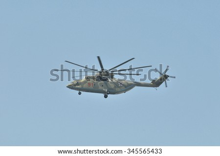 MOSCOW, RUSSIA - MAY 9, 2010: Military parade of 65th anniversaries of a victory devoted to celebrating in WWII. Heavy Russian Mi-26 helicopter  in the sky over Moscow flies up to Red Square