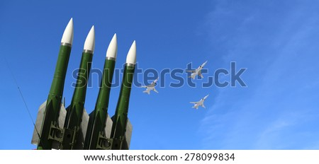 MOSCOW, RUSSIA - MAY, 07 2015: Modern Russian anti-aircraft missiles and military aircrafts fly in formation against the sky   - stock photo