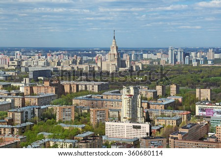 MOSCOW, RUSSIA - MAY 05, 2015: Moscow cityscape. Top view on the South-Western region and the main building of the Lomonosov Moscow State University (MSU) - stock photo