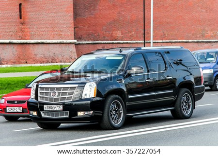 MOSCOW, RUSSIA - MAY 5, 2012: Motor car Cadillac Escalade in the city street. - stock photo