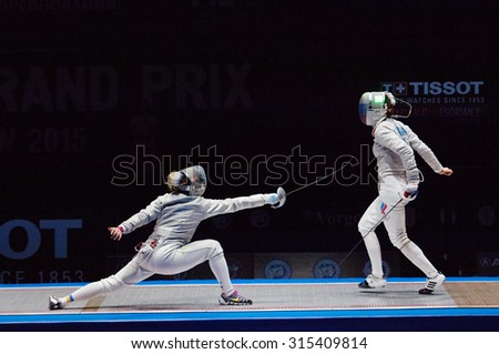 MOSCOW, RUSSIA - MAY 31 2015: O. Kharlan (L) and S. Velikaya (R) fights on final during the World  fencing Grand Prix Moscow Saber in Luzhniki sport palace - stock photo