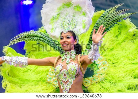 MOSCOW, RUSSIA - 18 MAY: Participants of annual carnival in Moscow in Ermitage Garden - latin dancer. Moscow, 18 may, 2013 - stock photo
