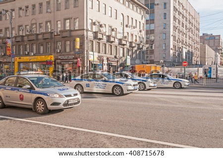 MOSCOW/RUSSIA - MAY 9: Police cars in row move on Tverskaya Street on parade  devoted to devoted to Victory Day on May 9, 2013 in Moscow.