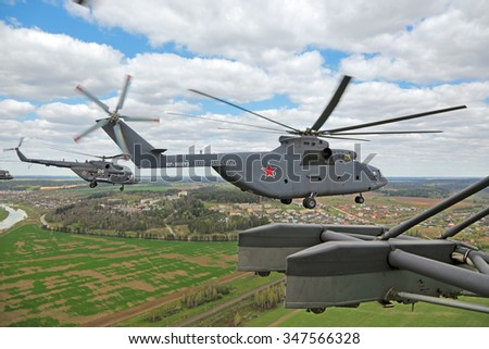 MOSCOW, RUSSIA - MAY 05, 2015: Rehearsal of parade of the 70th anniversary of the Victory Day. A group of military helicopters the participants of the Airshow fly to Moscow from the Kubinka airfield - stock photo