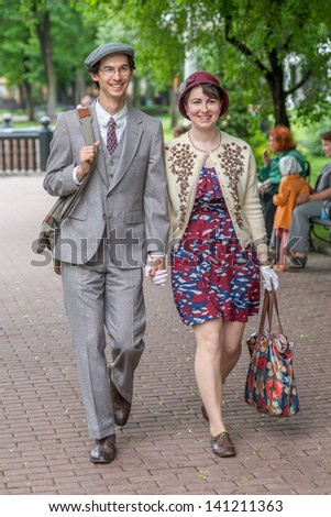 MOSCOW, RUSSIA -  MAY 26: Retro festival 'Days of history' in Hermitage Garden. Couple wearing retro style clothes. Moscow, May 26, 2013