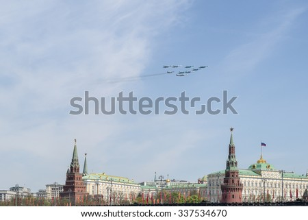 MOSCOW, RUSSIA - MAY, 09 2015: Russian fighters fly in formation over Red Square during Victory Day parade, Russia. Celebration of the 70th anniversary of the Victory Day - stock photo
