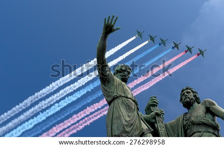 MOSCOW, RUSSIA - MAY, 07 2015: Russian military aircrafts fly in formation over Moscow during Victory Day parade, Russia. Celebration of the 70th anniversary of the Victory Day (WWII) - stock photo