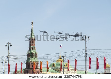 MOSCOW, RUSSIA - MAY, 09 2015: Russian military helicopters fly in formation over Moscow during Victory Day parade, Russia. Celebration of the 70th anniversary of the Victory Day - stock photo