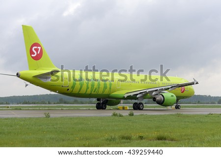 MOSCOW, RUSSIA - MAY 19, 2016: S7 airlines Airbus A321 plane makes taxiing on taxiway Domodedovo International Airport. - stock photo