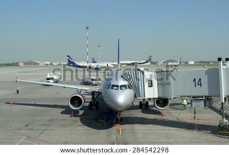 MOSCOW, RUSSIA - MAY 23, 2011: Sheremetyevo international airport. Passenger aircraft Airbus A-319 at boarding ladder - stock photo