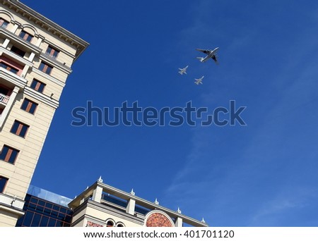 MOSCOW, RUSSIA - MAY 07, 2015:Simulation of refueling in the air from the aircraft-tanker Il-78M front-line bomber with variable sweep wing su-24 over Moscow. Rehearsal of parade.