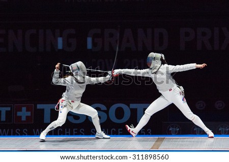 MOSCOW, RUSSIA - MAY 31 2015: Sofia Velikaya attack Jung Kim  on the World  fencing Grand Prix Moscow Saber in Luzhniki sport palace - stock photo