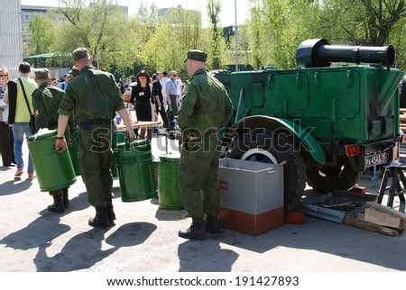 MOSCOW, RUSSIA - MAY 09, 2013: Soldiers prepare war times kitchen. Victory Day celebration in Moscow.