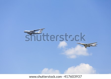 MOSCOW, RUSSIA - MAY 9, 2016: Soviet air tanker Ilyushin IL-78 and Soviet strategic bomber Tupolev Tu-95 simulate in-flight refueling at Parade of Victory in World War II May 9, 2016 in Moscow