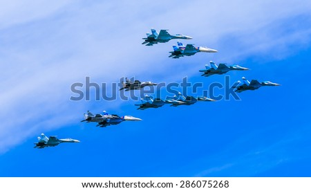 MOSCOW/RUSSIA - MAY 9: 4 Su-34 Fullback bombers, 4 Su-27 Flanker supermanoeuverable and 2 MiG-29 Fulcrum jet fighters form Tactical Wing on parade devoted to Victory Day on May 9, 2015 in Moscow. - stock photo