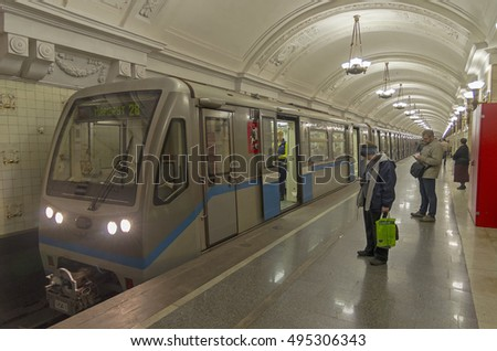 "MOSCOW, RUSSIA - MAY 15, 2015:  Subway train with open doors stands on the station ""Oktyabrskaya"" on the ring line."