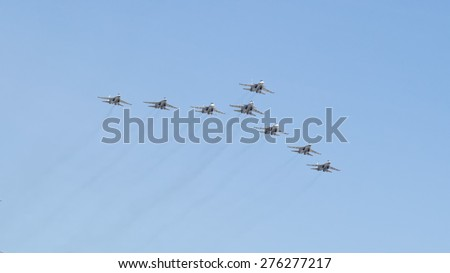 MOSCOW/RUSSIA - MAY 7: 8 Sukhoi Su-30SM (Flanker-C) and Su-35 (Flanker-E) twin-engined supermaneuverable fighters on rehearsal of parade devoted to Victory Day aniversary on May 7, 2015 in Moscow.