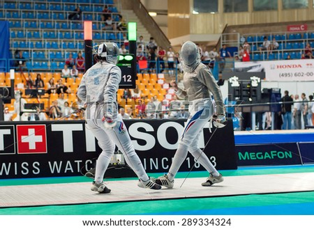 MOSCOW, RUSSIA - MAY 31 2015: Svetlana Kormilitsyna (RUS) and Sara Balzer (FRA) fights on the World  fencing Grand Prix Moscow Saber in Luzhniki sport palace - stock photo