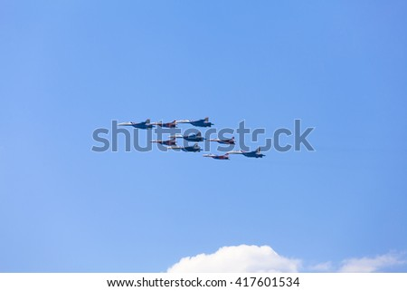 MOSCOW, RUSSIA - MAY 9, 2016: Tactical wing consisted with Sukhoi Su-27, Su-34 and Mikoyan Gurevich MiG-29SMT of Russian Air Force during Victory Day parade pictured over Moscow city
