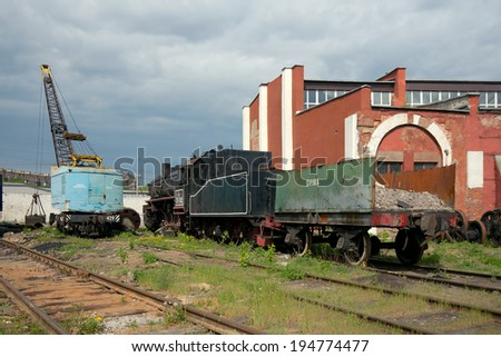 Moscow, Russia - May 17 2014: TE-3162 steam locomotive with open wagon and crane at depot on old railway station Podmoskovnaya.